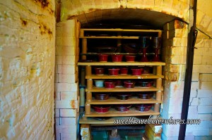 Large Kiln Made With White Bricks With Red Glazed Pottery on Shelves Inside