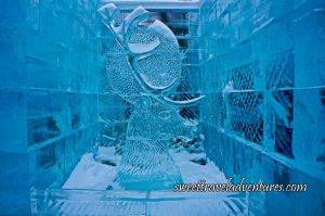 An Ice Sculpture of a Head of a Deer and Antlers With Ice Walls on Two Sides and Behind it