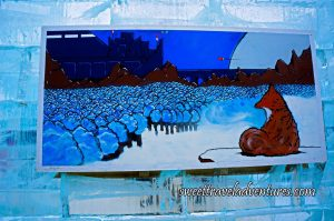 A Painting of a Fox Looking at the City Behind a Forest Hanging on an Ice Wall